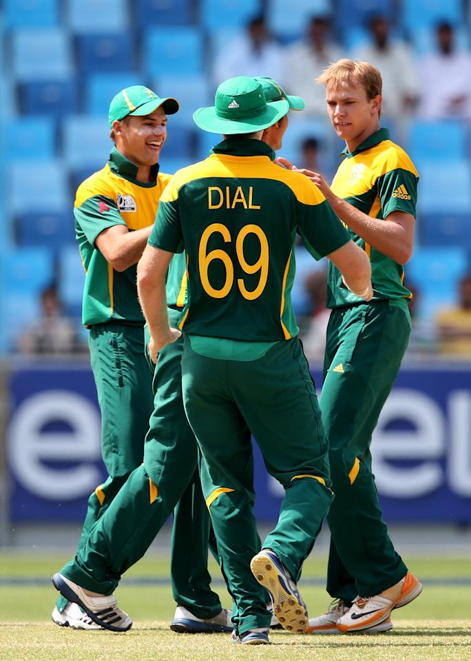 DUBAI, UNITED ARAB EMIRATES - MARCH 01:  Justin Dill of South Africa celebrate with teammates during the ICC U19 Cricket World Cup 2014 Super League Final match between South Africa and Pakistan at the Dubai Sports City Cricket Stadium on March 1, 2014 in Dubai, United Arab Emirates.  (Photo by Francois Nel - IDI/IDI via Getty Images)
