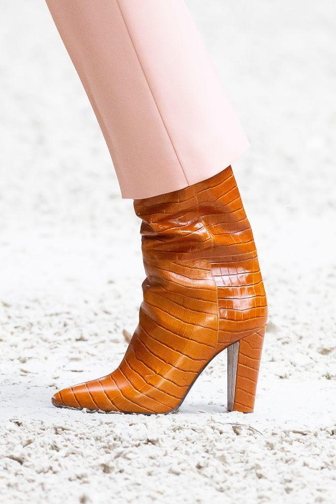 Longchamp's croc-embossed leather stacked boot for fall '21. - Credit: WWD
