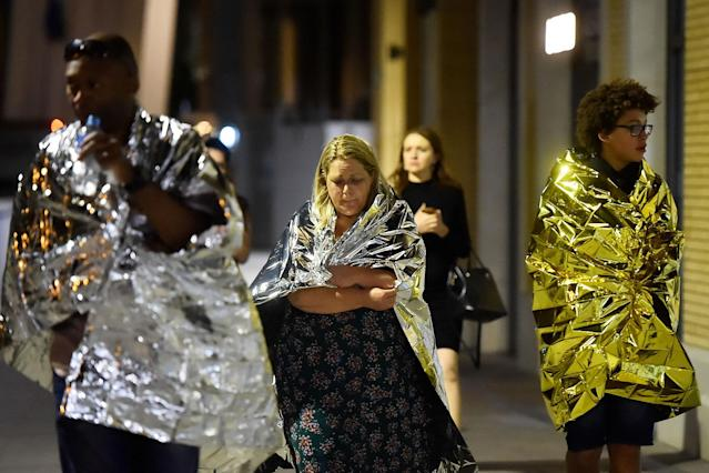 <p>People flee as police attend to an incident near London Bridge in London, Britain, June 4, 2017. (Hannah McKay/Reuters) </p>
