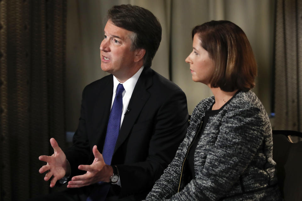 SCOTUS nominee Brett Kavanaugh (with his wife, Ashley Estes Kavanaugh) answered questions during a Fox News interview on Sept. 24, about allegations of sexual misconduct against him. (Photo: AP Photo/Jacquelyn Martin)