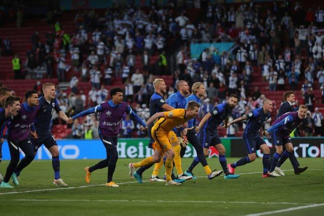 Finland players celebrate with their fans after the Euro 2020 win over Denmark in Copenhagen
