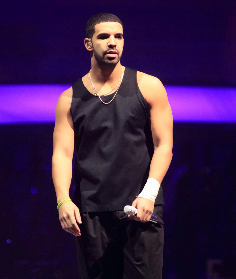 """FILE - This Dec. 18, 2013 file photo shows rapper Drake on the last date of his """"Would You Like A Tour? 2013"""" at the Wells Fargo Center in Philadelphia. Drake says he won't do interviews with magazines following his recent story in Rolling Stone magazine. The rapper was supposed to cover the magazine's new issue, but was replaced with the late Philip Seymour Hoffman. Drake tweeted Thursday he's """"done doing interviews with magazines."""" (Photo by Owen Sweeney/Invision/AP, File)"""