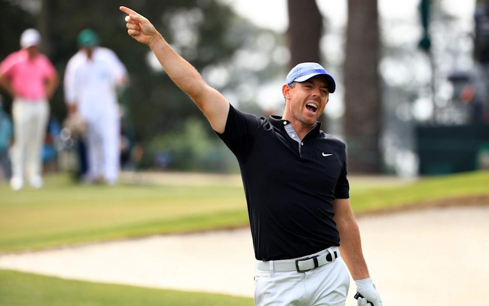 Rory McIlroy of Northern Ireland reacts to his shot from the third tee during the first round of the Masters - Getty Images