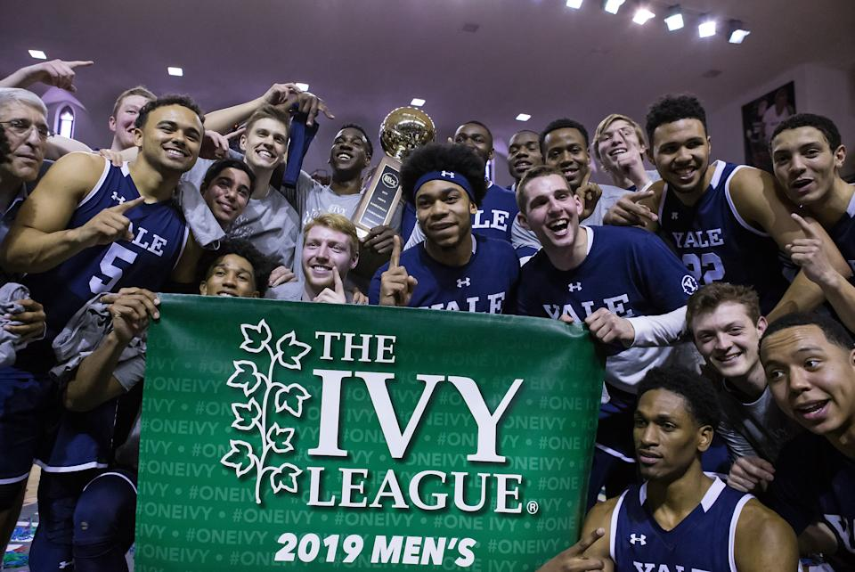 NEW HAVEN, CT - MARCH 17: Yale Bulldogs players celebrate after defeating the Harvard Crimson and wining the Ivy League Championship on March 17, 2019, at John J. Lee Amphitheater in New Haven, CT. (Photo by M. Anthony Nesmith/Icon Sportswire via Getty Images)