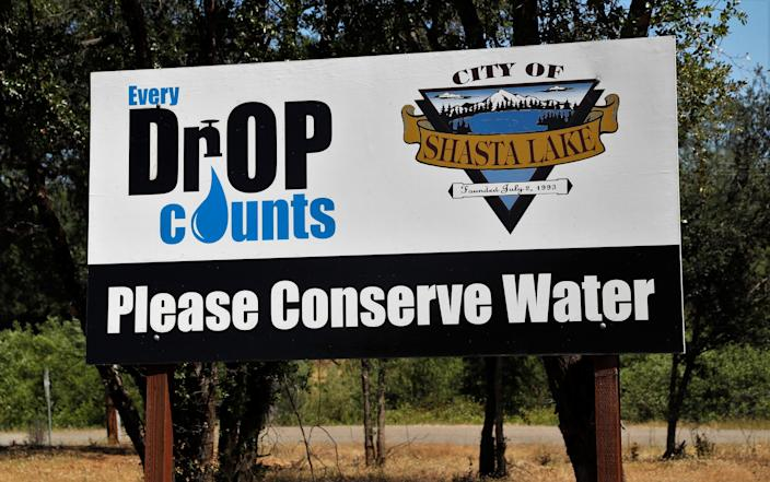 A sign along Pine Grove Avenue in Shasta Lake asks residents to conserve water during the 2021 drought.