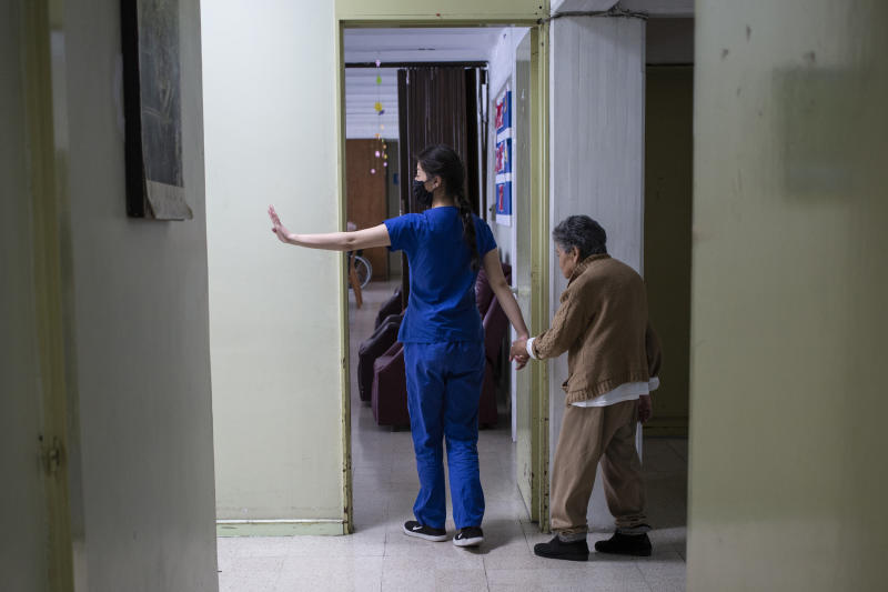 TOLUCA, MEXICO - APRIL 02: A nurse indicates that passage is restricted to prevent nursing home residents from getting Coronavirus on April 02, 2020 in Toluca, Mexico. Health Emergency was declared by National Government and Non-essential activities have been suspended nationwide until April 30. The Coronavirus (COVID-19) pandemic has spread to many countries across the world, claiming over 44,000 lives and infecting hundreds of thousands more. (Photo by Cristopher Rogel Blanquet/Getty Images)