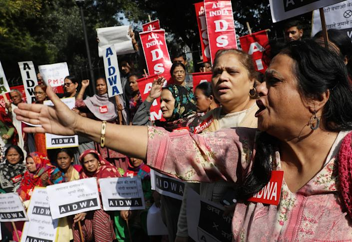 Activists hold placards and shout slogans as they protest over the Hyderabad rape case in Delhi on Monday: EPA