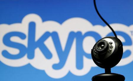 FILE PHOTO: A web camera is seen in front of a Skype logo in this photo illustration taken in Zenica