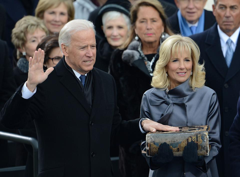 Joe Biden is sworn-in as vice-president with his wife Jill on Jan. 21, 2013, in Washington, DC. (Photo: AFP via Getty Images)