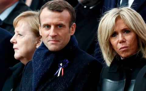 (From L) German Chancellor Angela Merkel, French President Emmanuel Macron and his wife Brigitte Macron attend a ceremony at the Arc de Triomphe in Paris on November 11, 2018 - Credit: BENOIT TESSIER/AFP