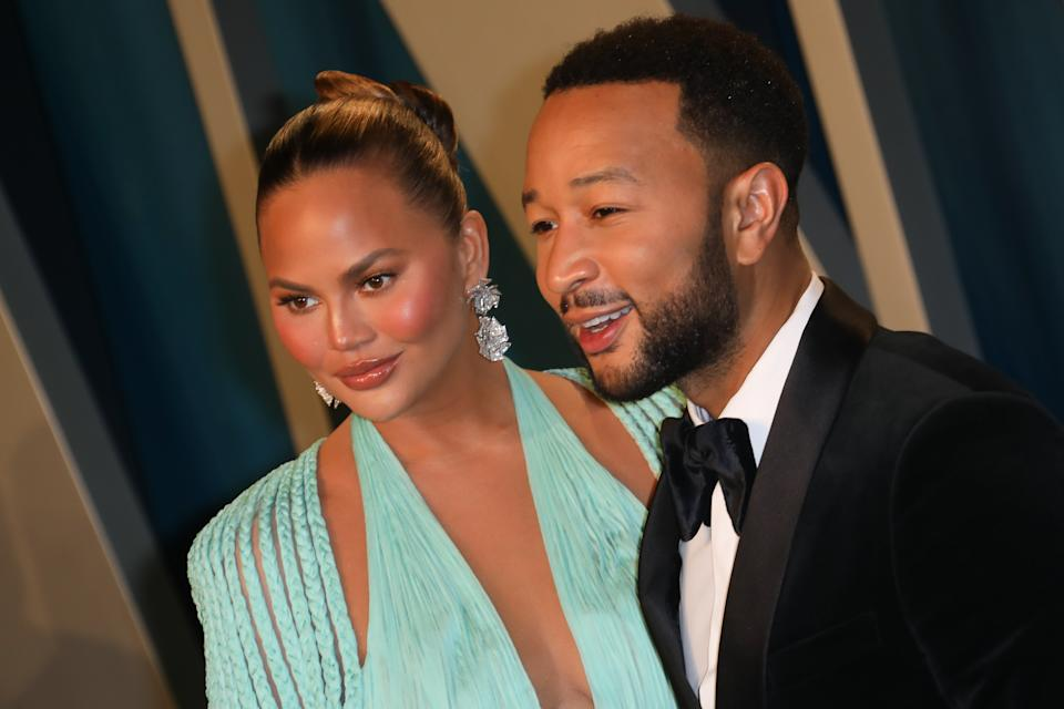 Chrissy Teigen and John Legend attend the 2020 Vanity Fair Oscar Party at Wallis Annenberg Center for the Performing Arts on February 09, 2020 in Beverly Hills, California. (Photo by Toni Anne Barson/WireImage)