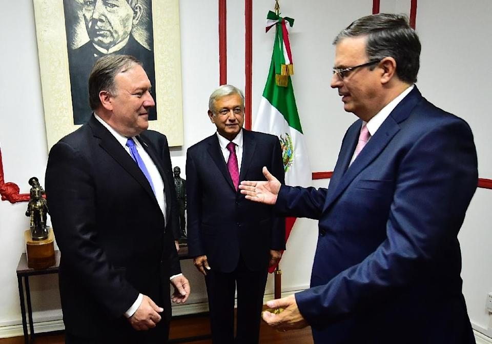 US Secretary of State Mike Pompeo (L) and Mexican Foreign Minister Marcelo Ebrard -- shown here in July in Mexico City with President Andres Manuel Lopez Obrador (C) after his election win -- held talks in Washington (AFP Photo/Pedro Pardo )