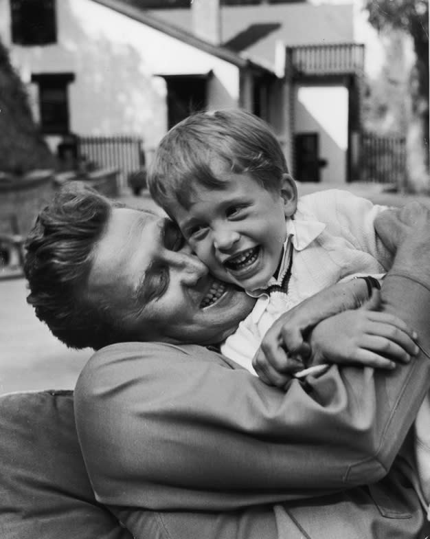 "Kirk Douglas hugs his son Michael in 1949. <br><br><br><a href=""http://life.time.com/news/fathers-day-special-life-with-famous-dads/#1"">Click here</a> to see the full collection at LIFE.com…"