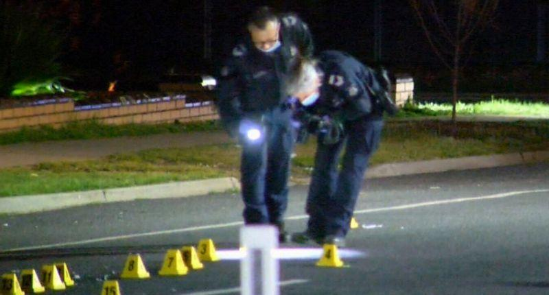 Two police officers at the scene of the crash in Kangaroo Flats, a suburb of Bendigo.