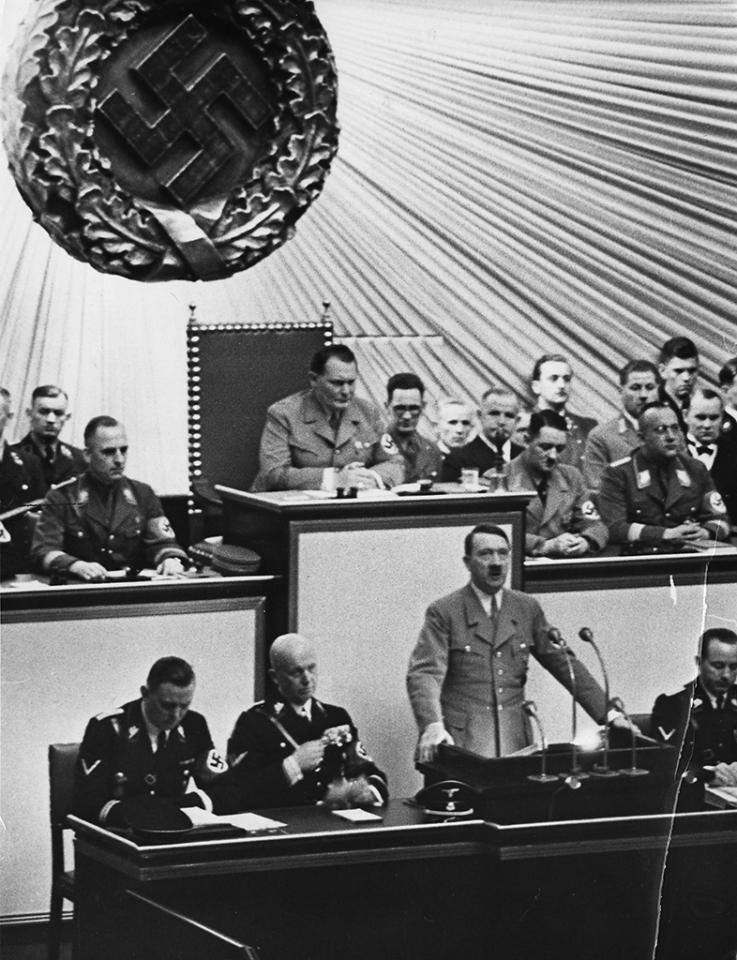 The Nazi invasion of  Poland and the start of World War II were just a few hours old when Fuehrer Adolf Hitler went before the Reichstag in Berlin, September 1, 1939, to deliver a war tirade without a formal declaration of war. From left are:  Julius Schaub, SS leader and Hitler's personal adjutant; Dr. Hans Lammers, chief of Reich Chancellery; and press chief  Dr. Otter Dietrich.   Behind Hitler is Herman Goering, German Field Marshall.  (AP Photo)