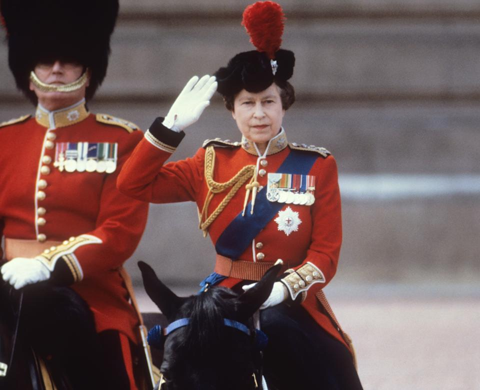 The Queen takes the salute of the Household Guards regiments during the Trooping of the Colour ceremony. She traditionally always rode on horseback, until 1986. (PA Images)