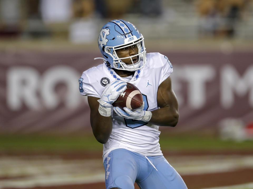 TALLAHASSEE, FL - OCTOBER 17: Running back Michael Carter #8 of the North Carolina Tar Heels on a kick-off during the game against the Florida State Seminoles at Doak Campbell Stadium on Bobby Bowden Field on October 17, 2020 in Tallahassee, Florida. The Seminoles defeated the Tar Heels 31 to 28. (Photo by Don Juan Moore/Getty Images)