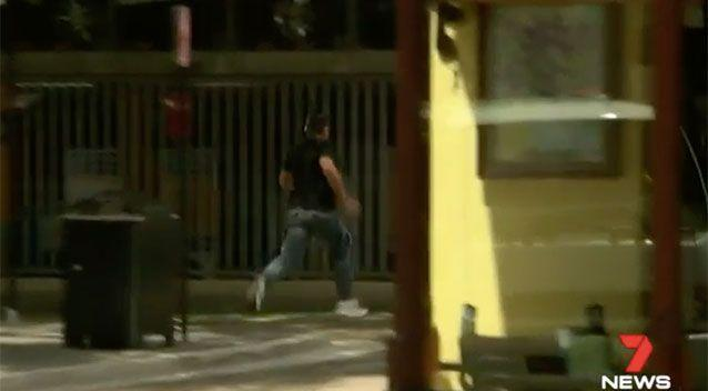 The Sydney father running from court on Tuesday. Source: 7 News