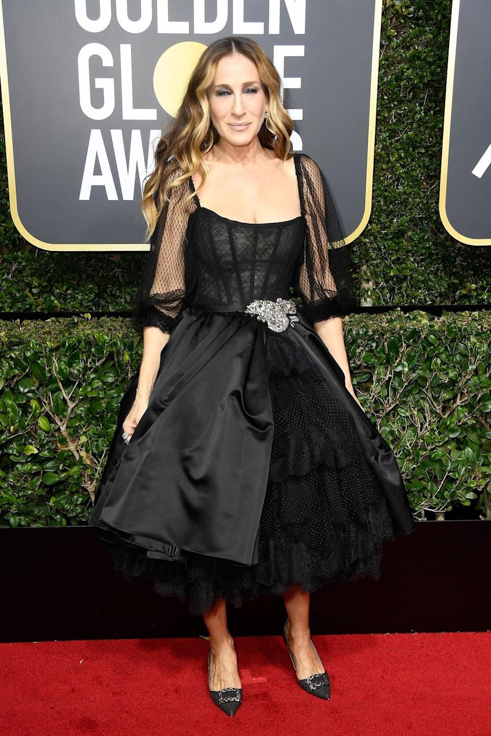 <p>Wearing a Dolce &amp; Gabbana dress with Fred Leighton jewels at the 2018 Globes. </p>