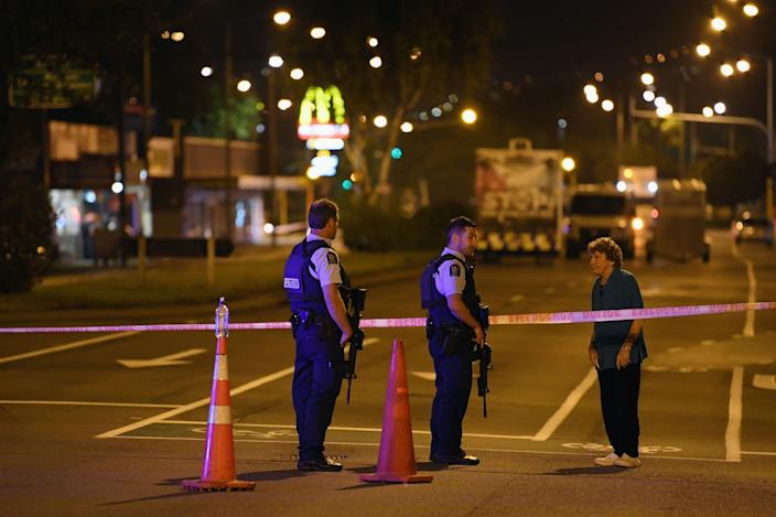Police speak to a resident as they cordon off Linwood Avenue near the Linwood Masjid on March 15, 2019 in Christchurch, New Zealand. 49 people have been confirmed dead and more than 20 are injured following attacks at two mosques in Christchurch. Four people are in custody following shootings at Al Noor mosque on Dean's Road and the Linwood Masjid in Christchurch. Mosques across New Zealand have been closed and police are urging people not to attend Friday prayers as a safety precaution. (Photo: Kai Schwoerer/Getty Images)