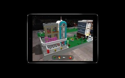 <span>Apple showed off how multiple people can see the same augmented reality Lego environment.&nbsp;</span>