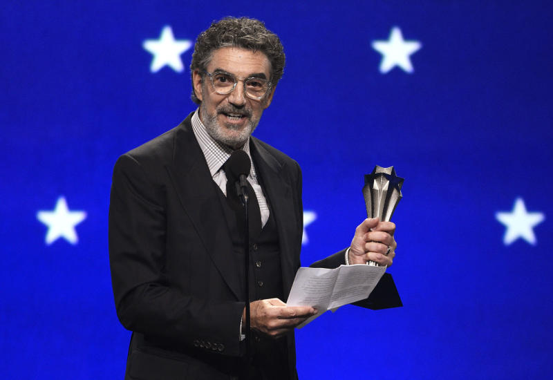 "FILE - In this Jan. 13, 2019, file photo, Chuck Lorre accepts the creative achievement award at the 24th annual Critics' Choice Awards at the Barker Hangar in Santa Monica, Calif. The end of ""The Big Bang Theory"" means the beginning of a familiar debate: is the traditional sitcom, complete with laugh track, a thing of the past? The hit CBS comedy concludes its 12-year run on Thursday, May 16. (Photo by Chris Pizzello/Invision/AP)"