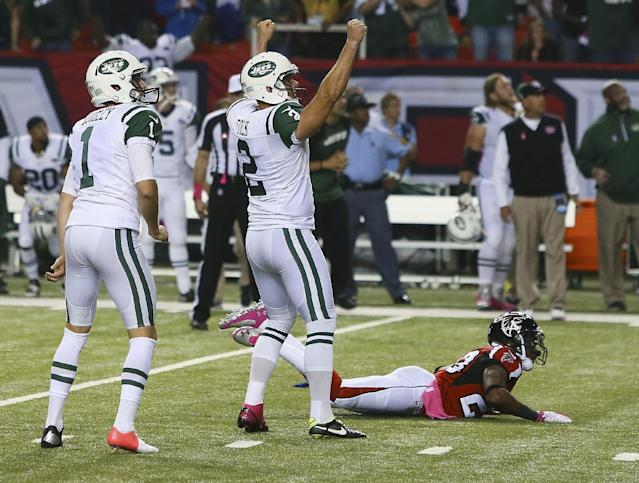 New York Jets kicker Nick Folk reacts to his game-winning field goal, as Atlanta Falcons' Robert Alford lies on the ground, having missed the block attempt in the fourth quarter of an NFL football game Monday, Oct. 7, 2013, in Atlanta. (AP Photo/Atlanta Journal Constitution, Curtis Compton)