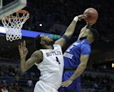 <p>Butler's Tyler Wideman fouls Middle Tennessee State's Antwain Johnson as he goes up for a shot during the first half of an NCAA college basketball tournament second-round game Saturday, March 18, 2017, in Milwaukee. (AP Photo/Morry Gash) </p>