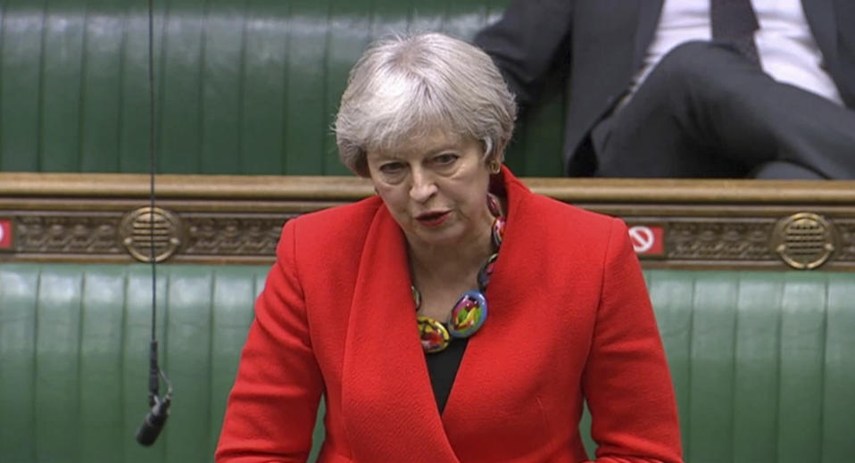In this screengrab provided by the House of Commons, Britain's Former prime minister Theresa May speaks during the debate in the House of Commons on the EU (Future Relationship) Bill in London, Wednesday, Dec. 30, 2020. The European Union's top officials have formally signed the post-Brexit trade deal with the United Kingdom, as lawmakers in London get set to vote on the agreement. (House of Commons via AP)