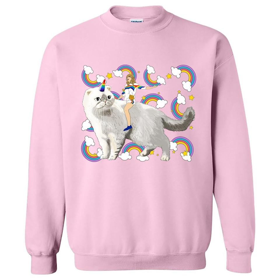 <p>We all know how much Taylor loves her cats, and this <span>Taylor Swift Sweater Caticorn &amp; Rainbows</span> ($29) proves it. </p>