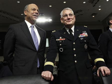Pentagon general counsel Jeh Johnson and Army General Ham attend hearing on Capitol Hill in Washington