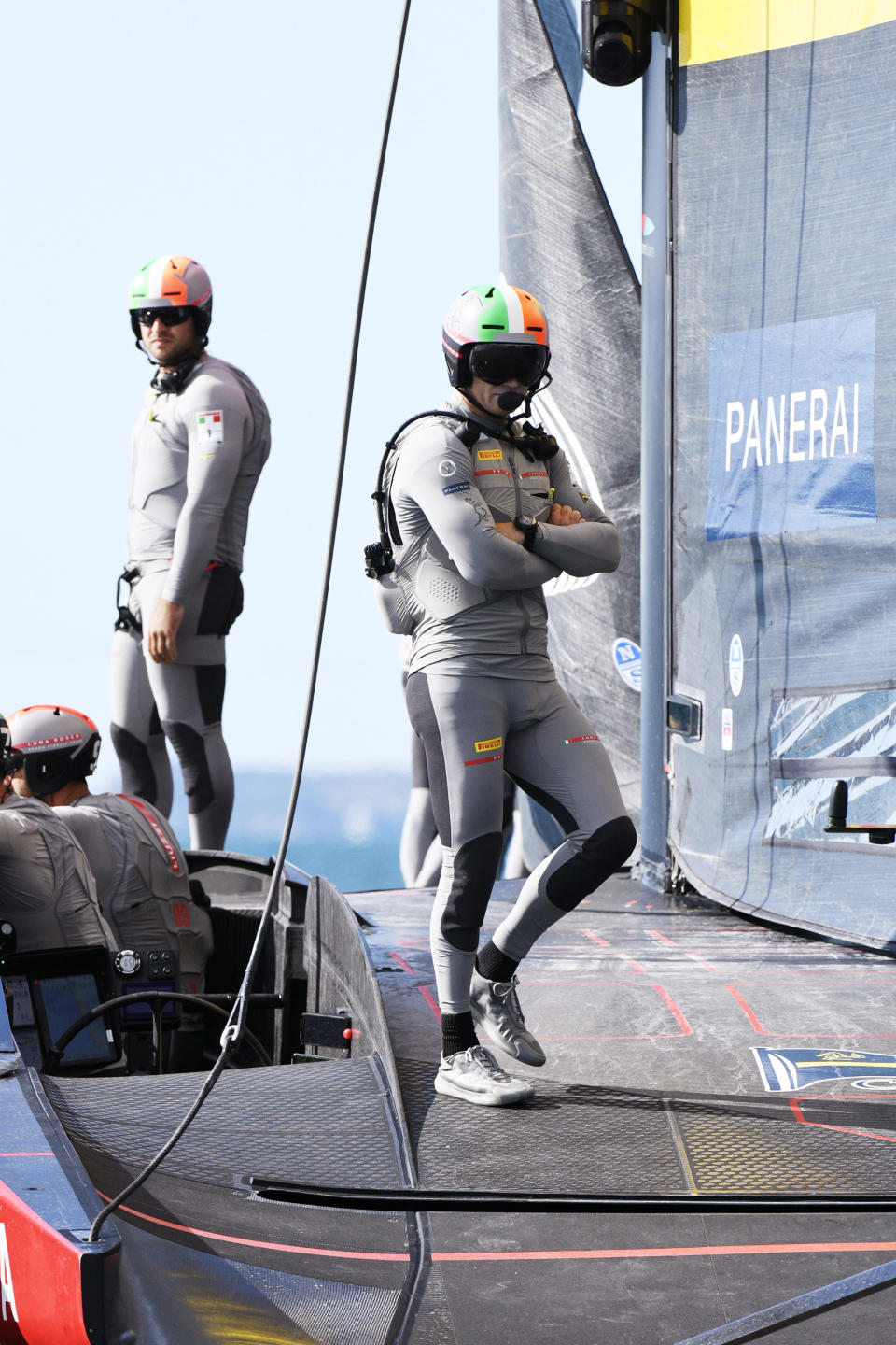 Jimmy Spithill, right, of Italy's Luna Rossa waits during a postponement of race 7 against Team New Zealand in the America's Cup on Auckland's Waitemata Harbour, New Zealand, Sunday, March 14, 2021. (Chris Cameron/Photosport via AP)