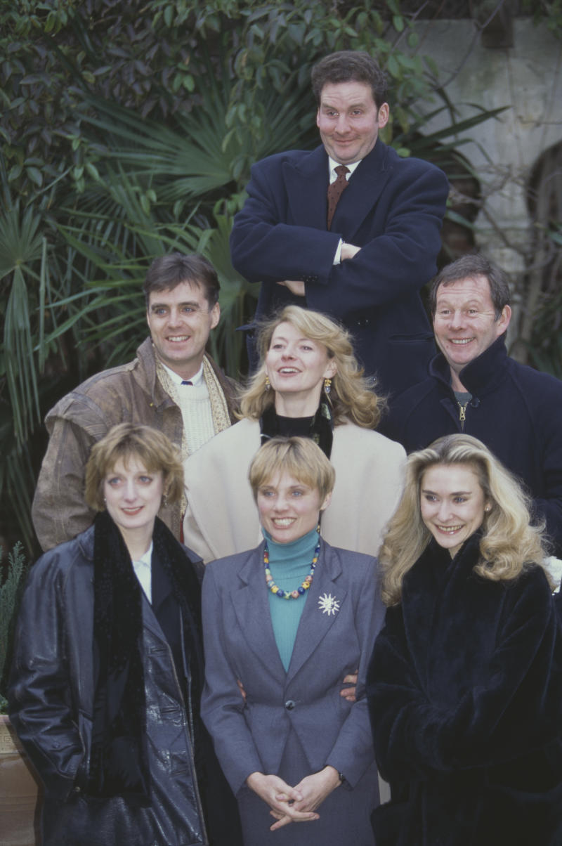 Cast of the BBC television sitcom series The Brittas Empire pictured together circa 1996. The cast are, clockwise from top: Chris Barrie, Michael Burns, Anouschka Menzies, Jill Greenacre, Judy Flynn, Tim Marriott and Pippa Haywood (centre). (Photo by Larry Ellis Collection/Getty Images)