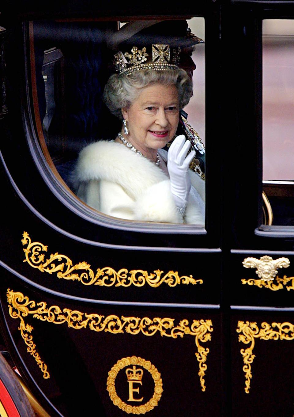 The Queen is rarely spotted waving to the public without her trusty white glove and there's no doubt the contraption would come in handy when she's expected to wave for extended periods of time. [Photo: Getty Images]