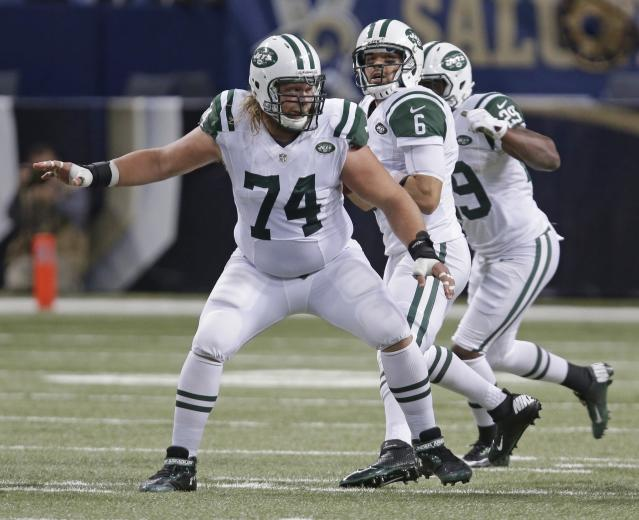 FILE - In this Nov. 8, 2012, file photo, New York Jets center Nick Mangold (74) drops back in protection for quarterback Mark Sanchez (6) during the third quarter of an NFL football game against the St. Louis Rams, in St. Louis. Former New York Jets center Nick Mangold has announced his retirement from playing football after 11 seasons in which he established himself as one of the NFL's best at his position. The 34-year-old Mangold announced on Twitter on Tuesday morning, April 17, 2018, that he will sign a one-day contract with the Jets to retire as a member of the team.(AP Photo/Tom Gannam, File)