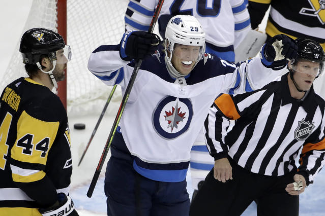 Winnipeg Jets' Patrik Laine (29) celebrates after assisting on a goal by Ville Heinola during the first period of an NHL hockey game against the Pittsburgh Penguins in Pittsburgh, Tuesday, Oct. 8, 2019. (AP Photo/Gene J. Puskar)