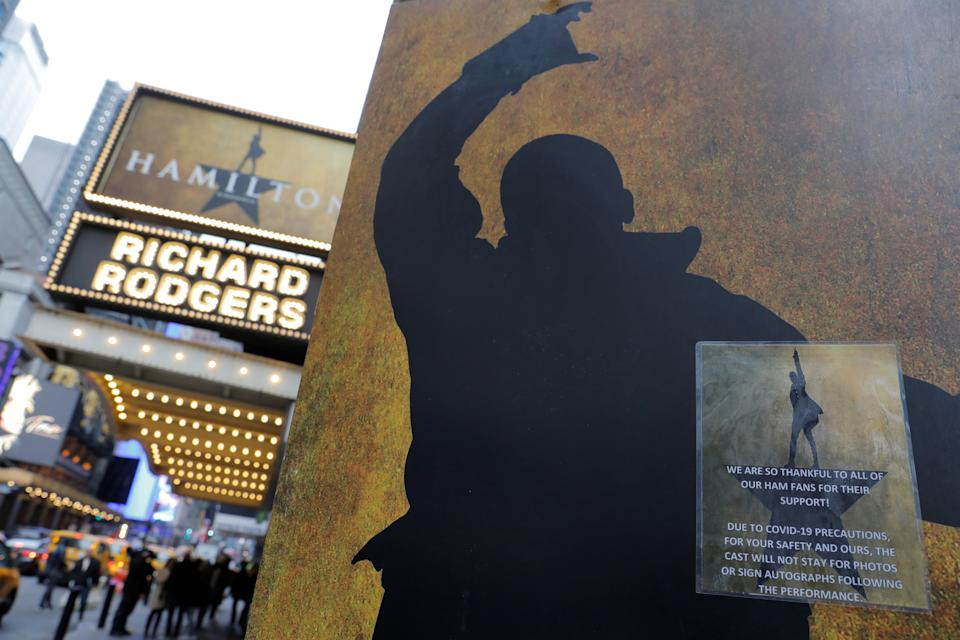Signage regarding the coronavirus is seen on the stage door to the show Hamilton at the Richard Rodgers theater as Broadway shows announced they will cancel performances due to the coronavirus outbreak in Manhattan, New York City, New York on March 12, 2020. (Andrew Kelly/Reuters)