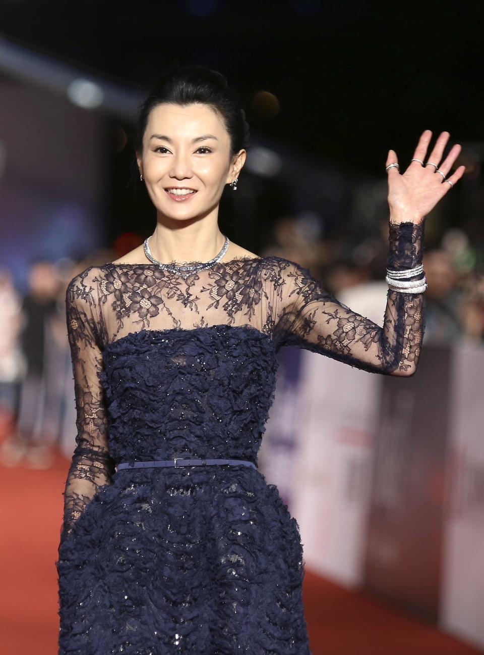 Hong Kong actress Maggie Cheung poses for photographers on the red carpet at the 50th Golden Horse Film Awards in Taipei November 23, 2013. REUTERS/Patrick Lin (TAIWAN - Tags: ENTERTAINMENT)