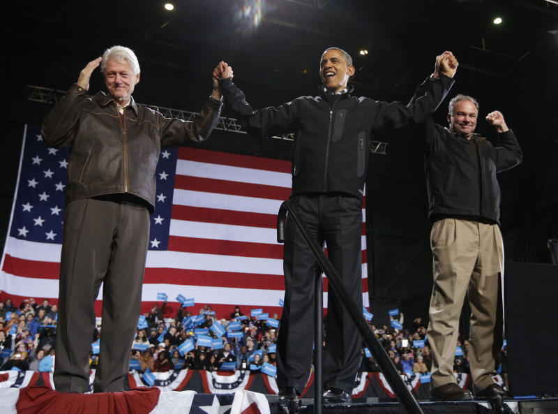 In the final hours of a four-state campaign day, President Barack Obama is joined by former President Bill Clinton, left, and Democratic candidate for the U.S. Senate from Virginia, former Gov. Tim Kaine, right, at a rally at Jiffy Lube Live arena, late Saturday night, Nov. 3, 2012, in Bristow, Va. (AP Photo/Pablo Martinez Monsivais)