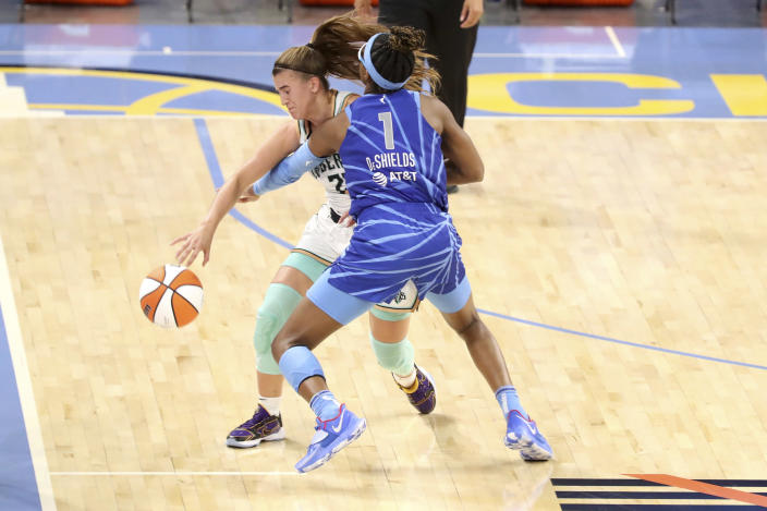 New York Liberty guard Sabrina Ionescu (20) tries to get past Chicago Sky guard Diamond DeShields (1) during a WNBA basketball game Sunday, May 23, 2021, in Chicago. (AP Photo/Eileen T. Meslar)