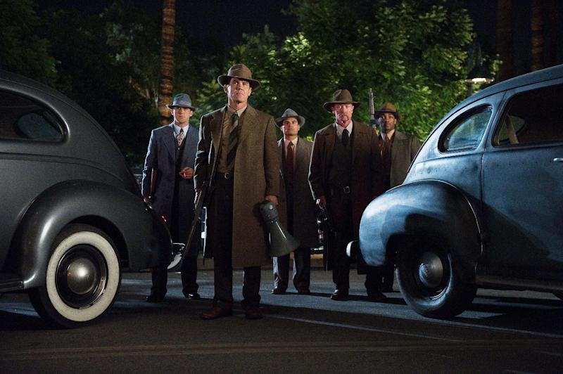 """This undated publicity photo released by Warner Bros. Pictures shows, from left, Ryan Gosling as Sgt. Jerry Wooters, Josh Broslin, as Sgt. John O'Mara, Michael Pena, as Officer Navidad Ramirez, Robert Patrick, as Officer Max Kennard, and Anthony Mackie, as Officer Coleman Harris, in Warner Bros. Pictures' and Village Roadshow Pictures' drama, """"Gangster Squad,"""" a Warner Bros. Pictures release. To bring the story of mobster Mickey Cohen's reign over post-war Los Angeles to life, the director of """"Gangster Squad"""" employed Sean Penn, Josh Brolin, Ryan Gosling and more than 100 irreplaceable vintage American cars. (AP Photo/Warner Bros. Pictures, Wilson Webb)"""