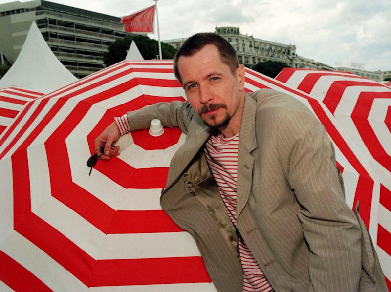 "British actor Gary Oldman poses at the Carlton beach in Cannes, French Riviera, Saturday May 10, 1997. Oldman is in Cannes to present his first movie as a director ""Nil by Mouth"" which is in competition during the International Film Festival. (AP Photo/Rhonda Galbraith)"