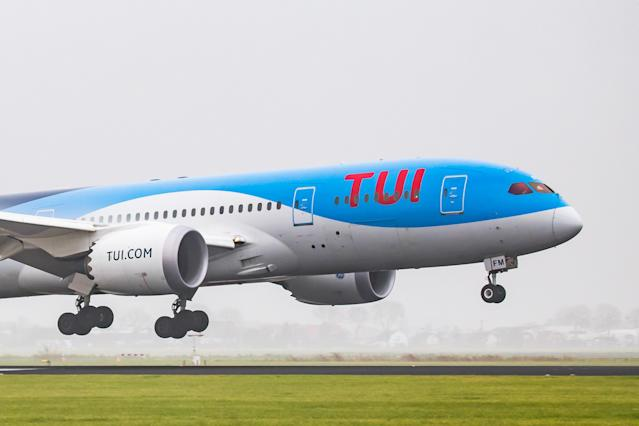A TUI aircraft landing in the mist at Amsterdam Schiphol International Airport. (Nicolas Economou/NurPhoto via Getty Images)