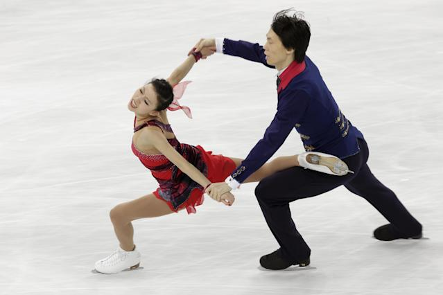 Pang Qing and Tong Jian of China compete in the pairs free skate figure skating competition at the 2014 Winter Olympics, Wednesday, Feb. 12, 2014, in Sochi, Russia. (AP Photo/Bernat Armangue)