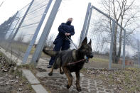 "Police officer Katarzyna Matuszewska after training with patrol dog Ort, in Warsaw, Poland, on Friday, March 19, 2021. When they age, the dogs and horses that serve in Poland's police, Border Guard and other services cannot always count on a rewarding existence. Responding to calls from concerned servicemen, the Interior Ministry has proposed a bill that would give the animals an official status and retirement pension, hoping this gesture of ""ethical obligation"" will win unanimous backing. (AP Photo/Czarek Sokolowski)"