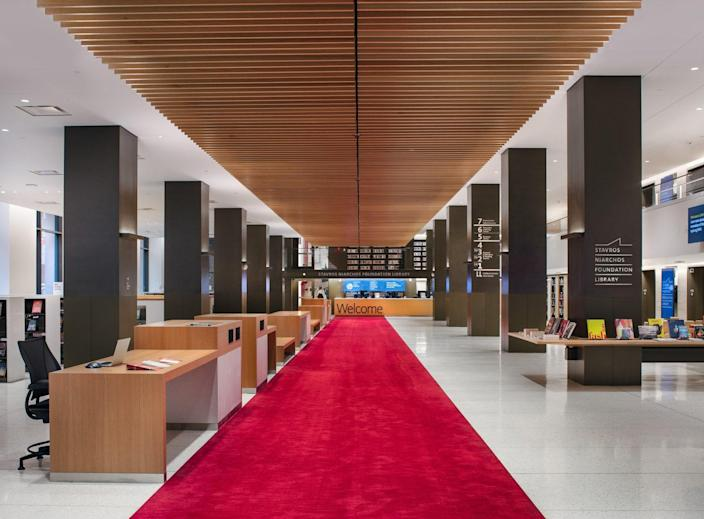 Visitors are greeted by a red carpet upon entry.