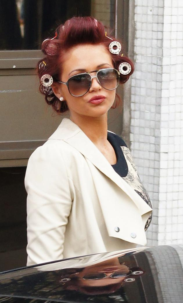 Celebrity photos: Amy Childs wasn't her glamorous self when she turned up at the ITV studios ahead of her appearance on Loose Women this week. The star arrived with all of her hair in rollers.