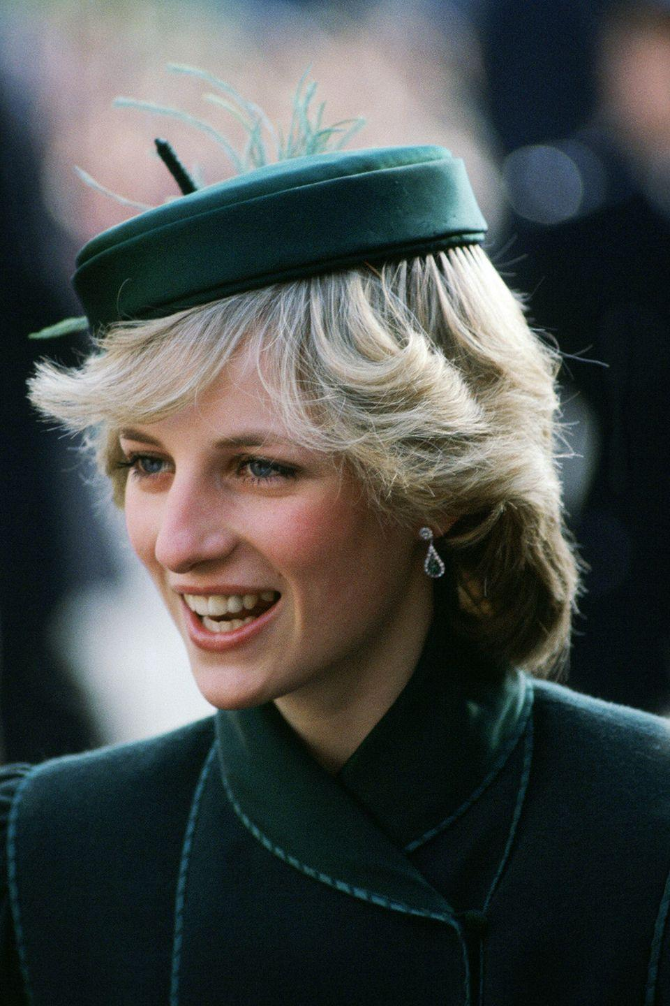 <p>Attending a charity concert at the Royal Albert Hall in a hunter-green circle cap.</p>