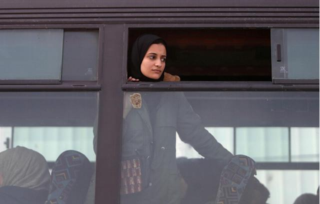 <p>A girl looks out of a bus window as she waits to cross into Egypt through the Rafah border crossing after it was opened by Egyptian authorities for humanitarian cases, in the southern Gaza Strip Feb. 7, 2018. (Photo: Ibraheem Abu Mustafa/Reuters) </p>