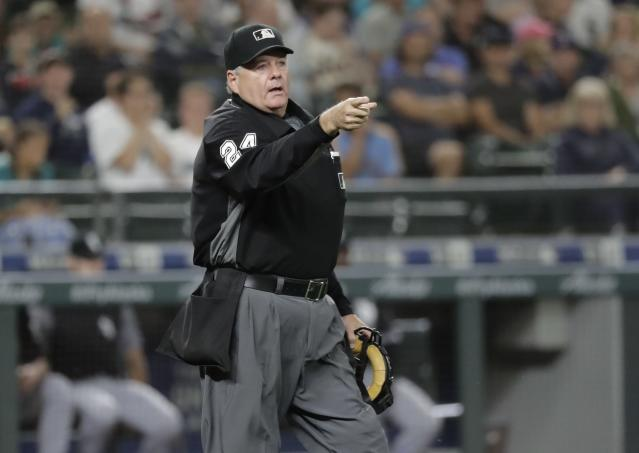Home plate umpire Jerry Layne makes a call during a baseball game between the Seattle Mariners and the Chicago White Sox, Friday, July 20, 2018, in Seattle. (AP Photo/Ted S. Warren)